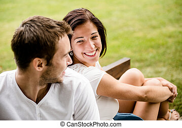 Young beautiful couple dating - Young smiling couple looking...