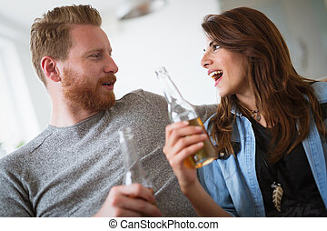 Young beautiful couple flirting and smiling at home