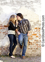 young beautiful couple kissing, room for text