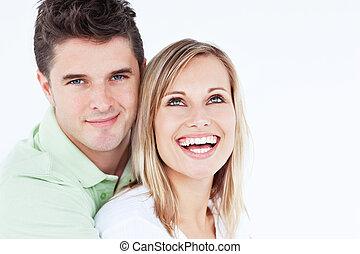 Young beautiful couple man looking at the camera