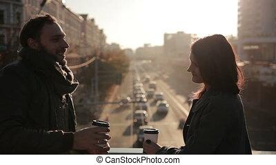 young beautiful couple met at the city bridge