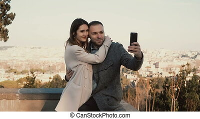 Young beautiful couple take the selfie photo against the...