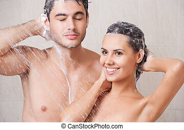 beautiful couple washing in the shower