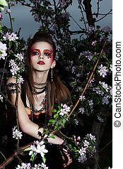 Young beautiful creative woman with color makeup - flowers
