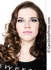 Young beautiful curly girl with professional make-up