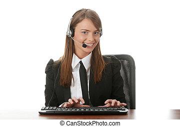 Young beautiful customer service operator girl in headset