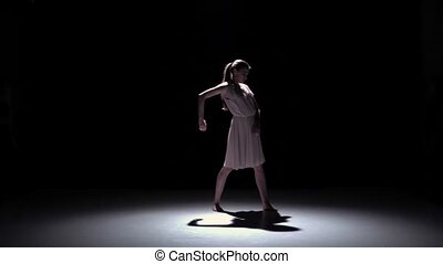 Young beautiful dancer in white dance contemporary on black, shadow, slow motion