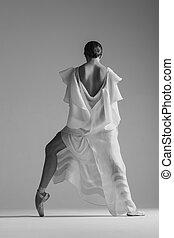 Young beautiful dancer is posing in studio - Young beautiful...