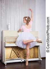 Young beautiful dancer posing in dance studio
