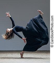 Young beautiful dancer posing in studio