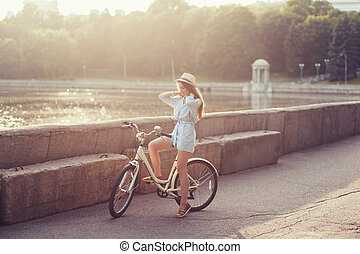 elegantly dressed woman with bicycle
