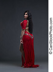 Young beautiful exotic eastern women performs belly dance in...