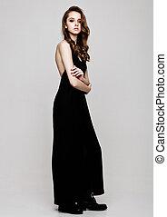 Young beautiful fashion model wearing black dress