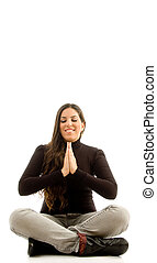 young beautiful female sitting with praying hands