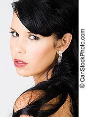 Young beautiful female wearing makeup