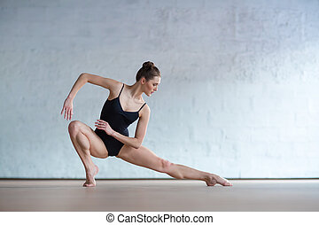 Young beautiful fitness female posing in studio - Young...