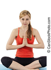 young beautiful fitness woman exercising yoga on white background