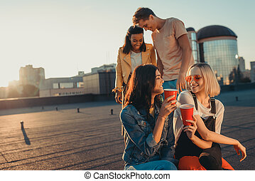 friends relaxing on roof party
