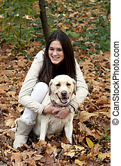Young beautiful girl and her dog