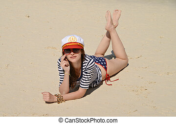 Young beautiful girl at the beach