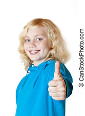 Young beautiful girl / child shows thumb up