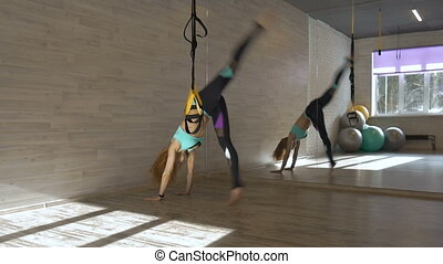 Young beautiful girl doing a handstand. This aerobic is an...