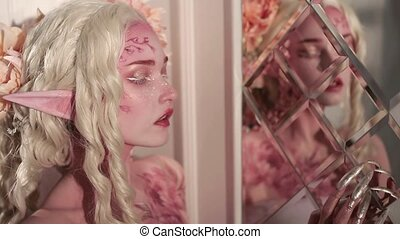 Young beautiful girl elf. Creative make-up and bodyart -...