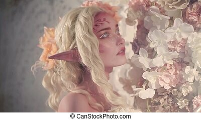 Young beautiful girl elf. Creative make-up and bodyart