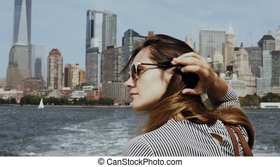 Young beautiful girl go for a boat through the East river in...