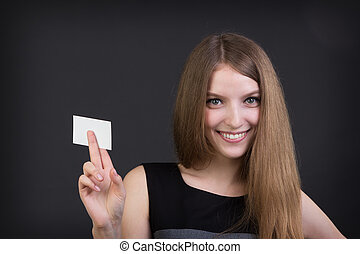 young beautiful girl holding a business card in hand
