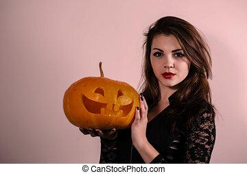 girl holding a pumpkin lantern