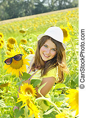 Young beautiful girl  in a sunflower field