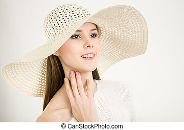 beautiful girl in a white hat