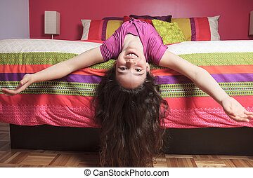 Young beautiful girl in bedroom