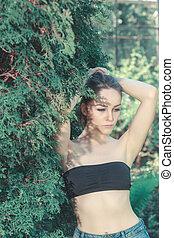 young beautiful girl in black top