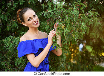 beautiful girl in blue dress outdoor