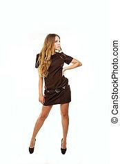 Young beautiful girl in brown dress