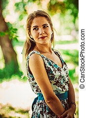 Young beautiful girl in floral dress