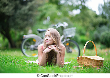 Young beautiful girl in the countryside