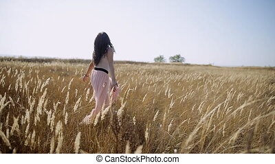 young beautiful girl in the field slow motion