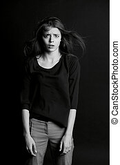 Young beautiful girl in the Studio. The emotion of despair,