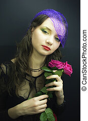 girl in veil with bouquet of roses