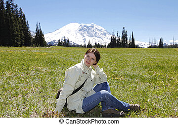 Young beautiful girl on the hiking trail. Mt Rainer, Washington