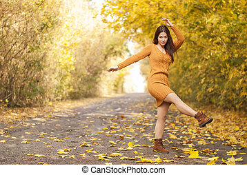 young beautiful girl on the road , autumn