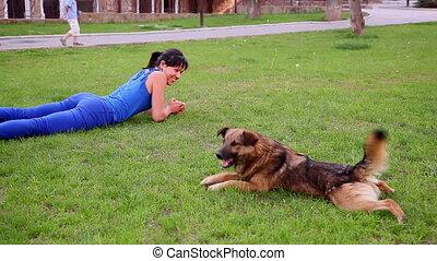 girl playing with dog
