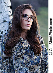 girl portrait with eyeglasses and scarf outdoor