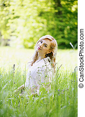 beautiful girl sitting in the grass