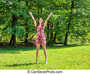 young beautiful girl standing hands up