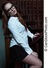 Young beautiful girl wearing school outfit