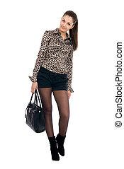Young beautiful girl with a black handbag